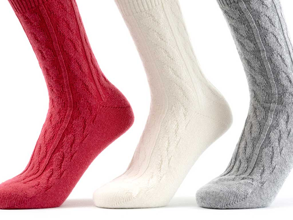 A selection of cashmere bed socks in red, white and grey